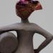 Femme africaine à la coiffe